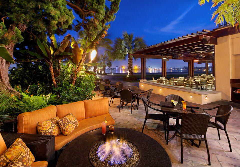 tree property Resort home Villa backyard restaurant swimming pool mansion hacienda landscape lighting condominium