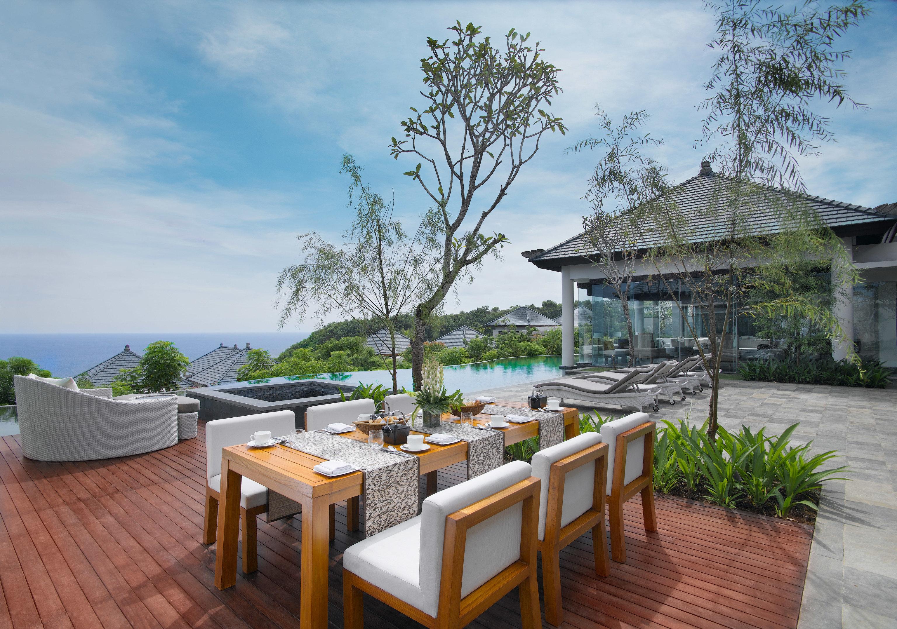 tree property Resort Villa cottage home swimming pool condominium backyard restaurant
