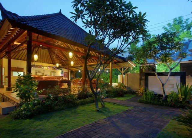 tree grass sky property Resort house home Villa hacienda eco hotel cottage backyard outdoor structure