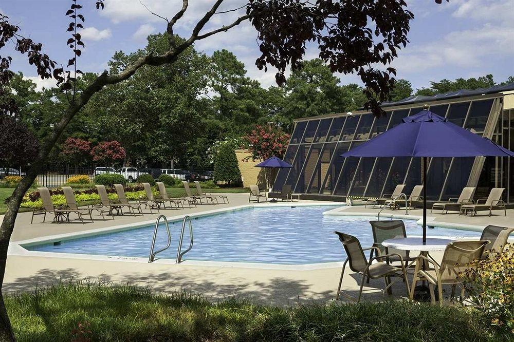 tree leisure swimming pool lawn Resort backyard Villa shore lined shade swimming