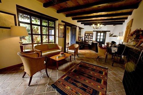property recreation room living room hardwood home cottage Villa Resort billiard room farmhouse wood flooring mansion