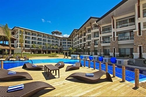 chair property Resort leisure condominium building plaza swimming pool convention center Villa blue lawn set