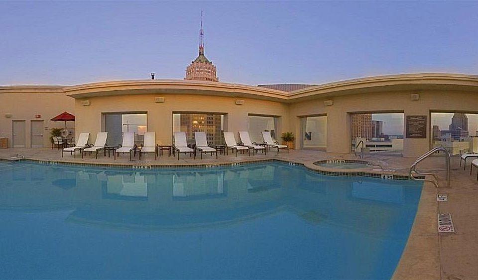 swimming pool property building mansion Villa Resort reflecting pool palace hacienda home blue condominium