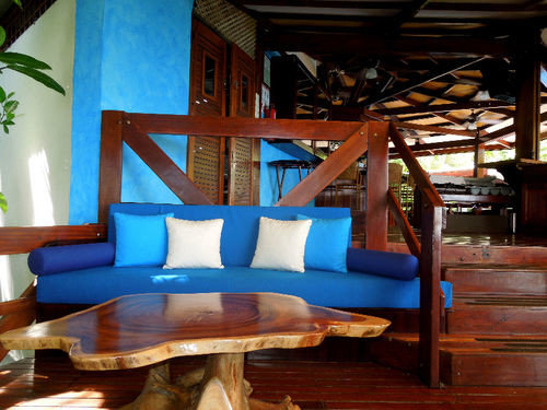 living room chair property blue wooden house home Resort cottage Villa seat