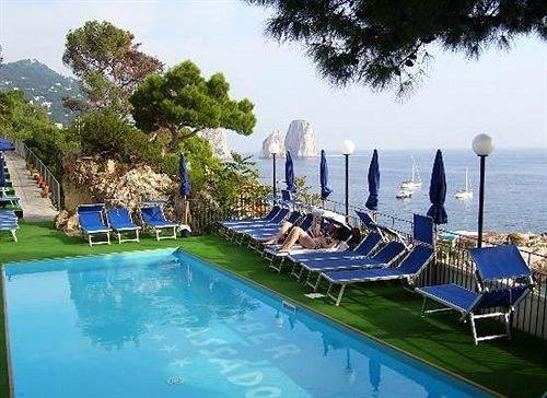 tree sky water swimming pool leisure property Resort marina condominium resort town dock Villa blue mansion lined