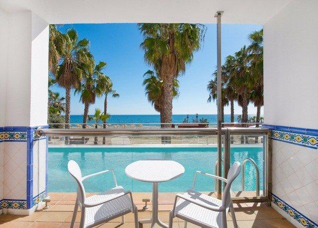 chair property swimming pool leisure condominium Resort building Villa caribbean hacienda home mansion porch dining table