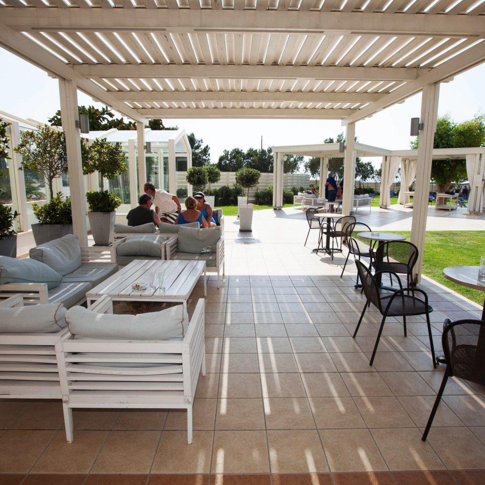chair building property Resort porch white outdoor structure restaurant Villa condominium