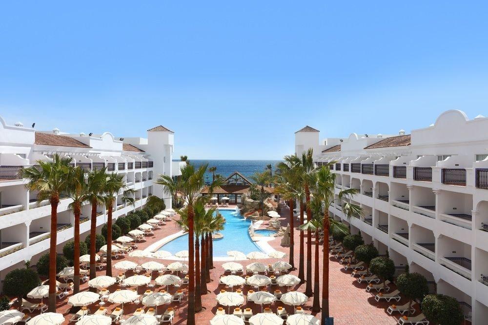 sky property building Resort condominium walkway Villa hacienda row palace lined line colonnade