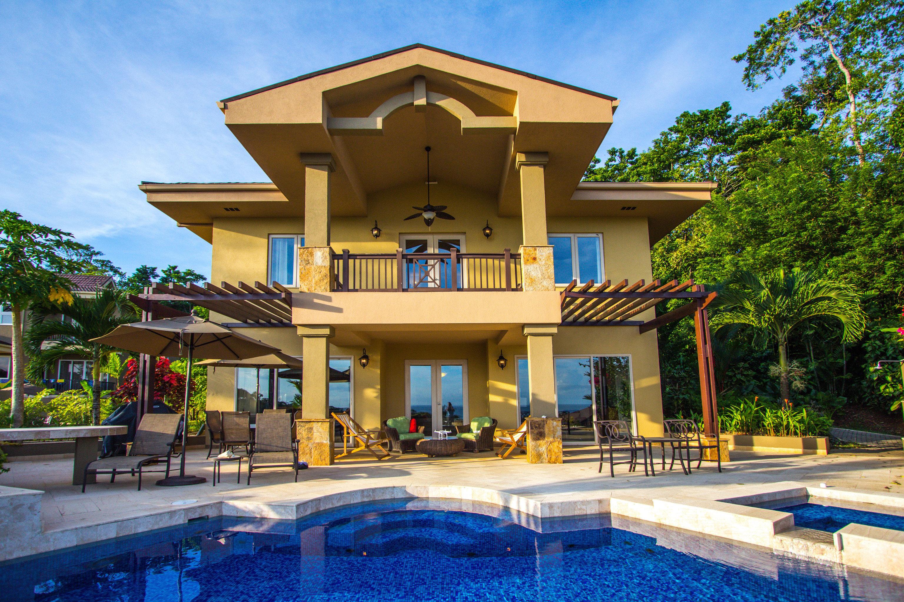 tree sky building property Resort house home condominium mansion Villa swimming pool