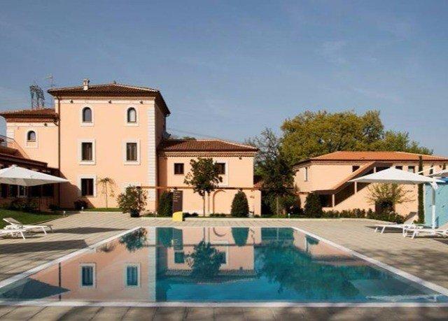 sky building property swimming pool house Villa home condominium Resort mansion hacienda residential