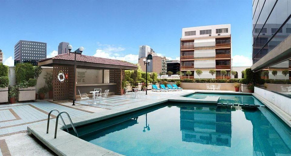 sky property swimming pool condominium building home Villa mansion Resort