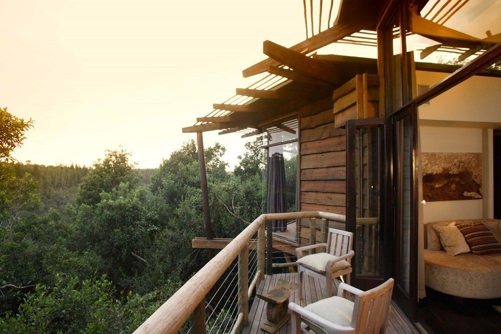 tree property building Resort cottage Villa home outdoor structure farmhouse eco hotel porch