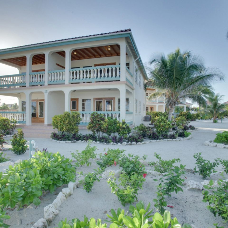 property Resort condominium home house residential area mansion Villa plant tree bushes