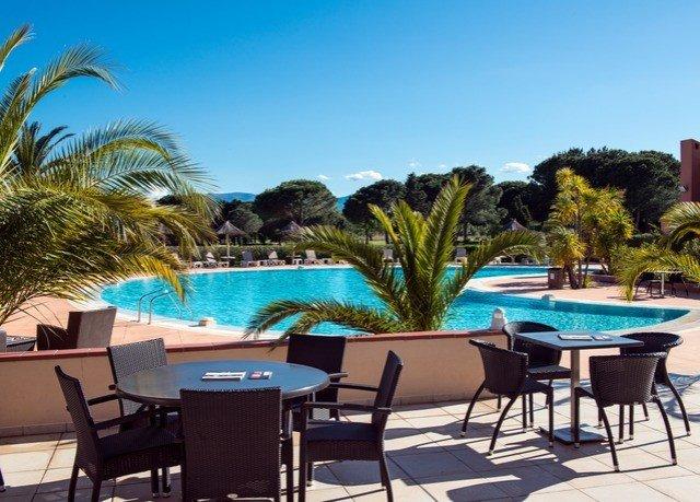 tree chair swimming pool leisure property Resort Villa caribbean condominium lawn hacienda set lined dining table