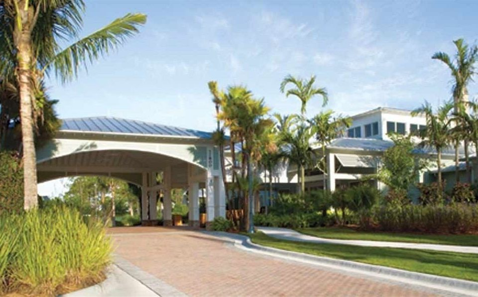 tree sky grass road property Resort condominium home Villa residential area palm caribbean hacienda plant walkway