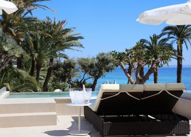 tree sky palm property swimming pool Resort caribbean Villa plant