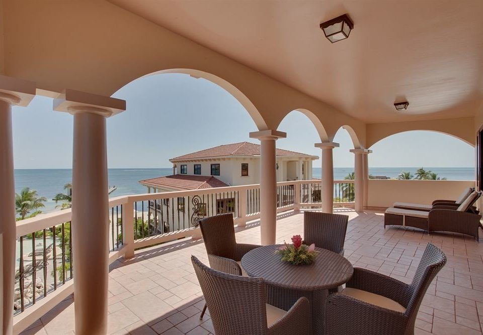 chair property Villa home Resort living room mansion condominium cottage hacienda outdoor structure colonnade
