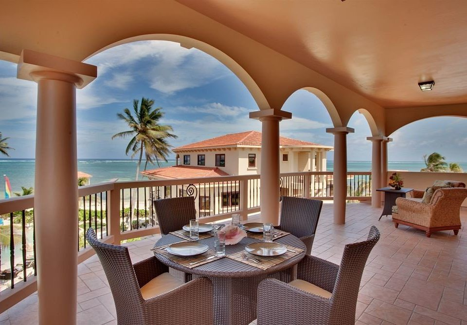 chair property Resort Villa hacienda home mansion condominium living room cottage swimming pool colonnade