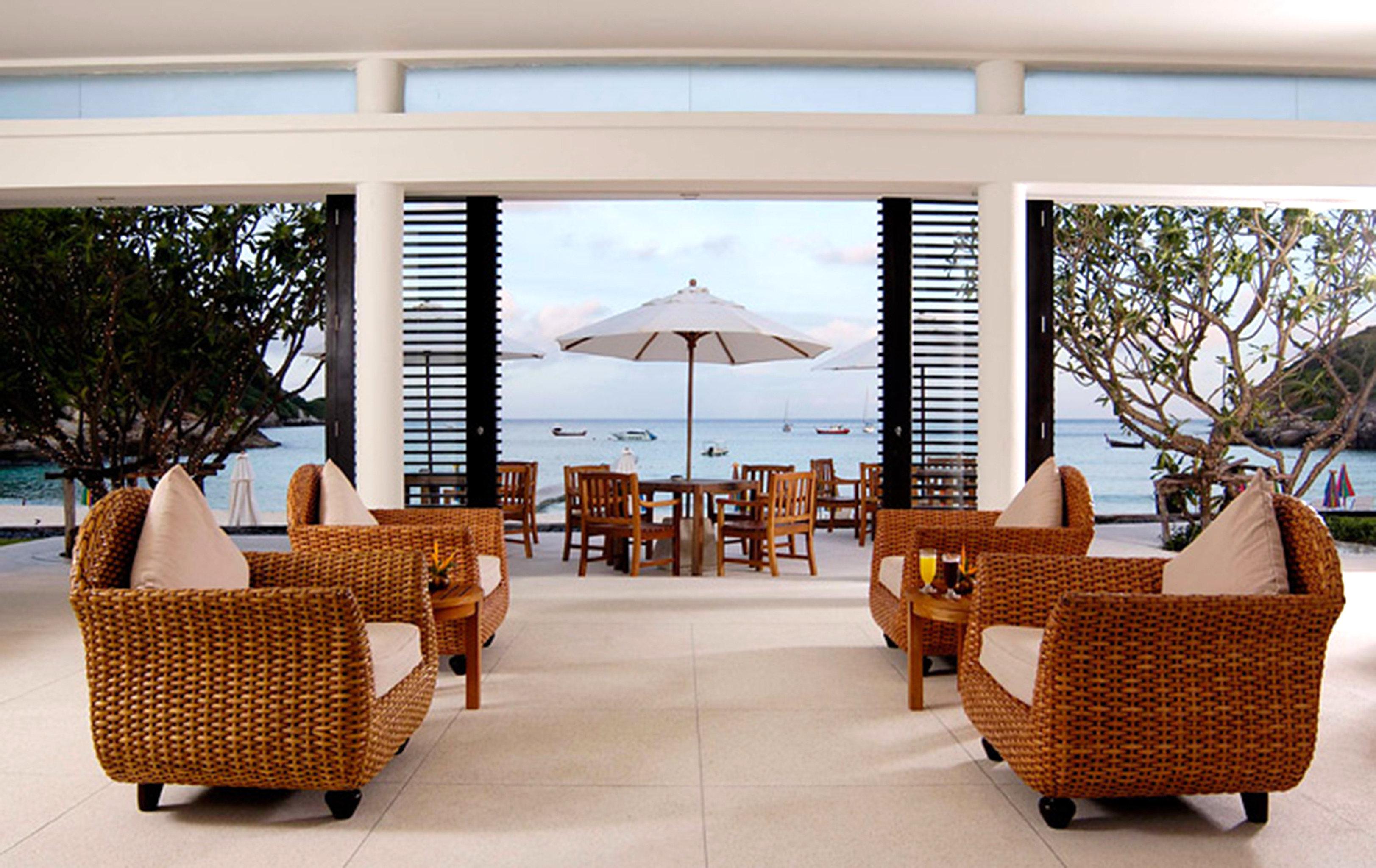 chair property Resort home living room porch outdoor structure Villa wicker condominium restaurant