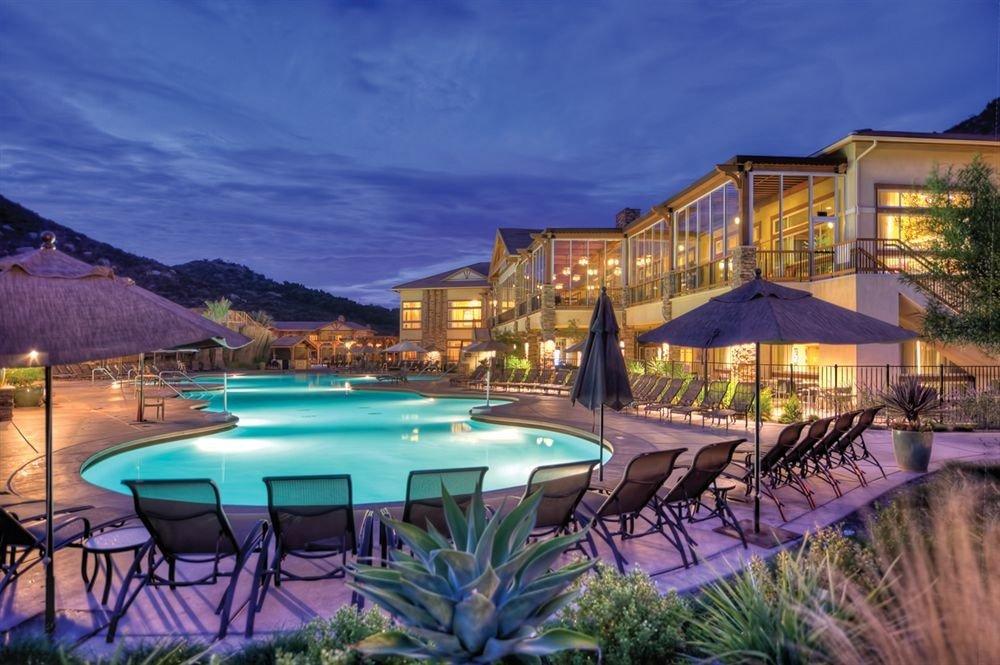 chair property swimming pool Resort home condominium Villa mansion row set shore lined