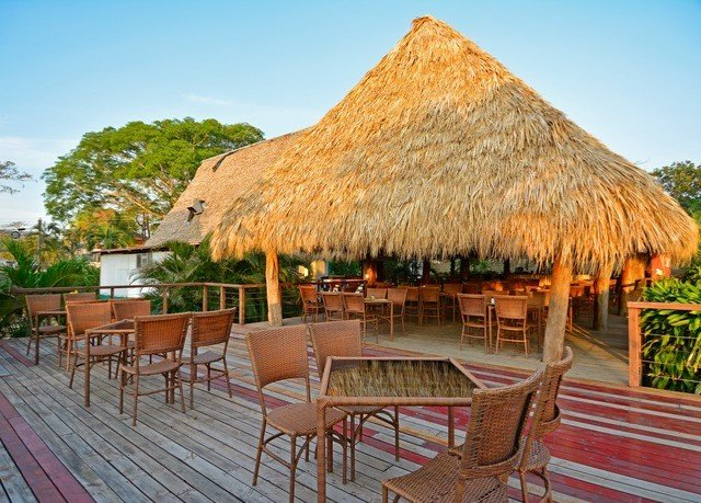 sky ground property chair Resort thatching hut cottage Villa outdoor structure roof