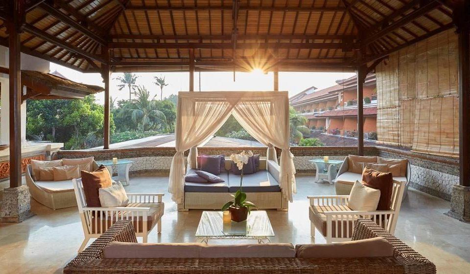chair property Resort Villa outdoor structure cottage hacienda eco hotel porch living room mansion