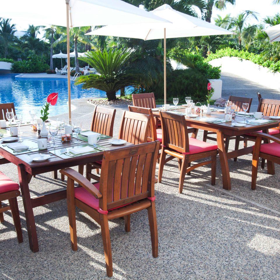 chair tree umbrella property restaurant Resort cottage Villa hacienda lawn set day