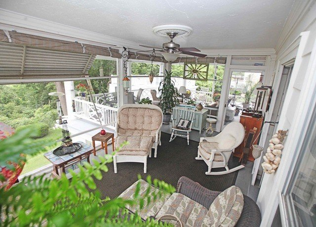 property chair porch home cottage outdoor structure Villa Resort farmhouse
