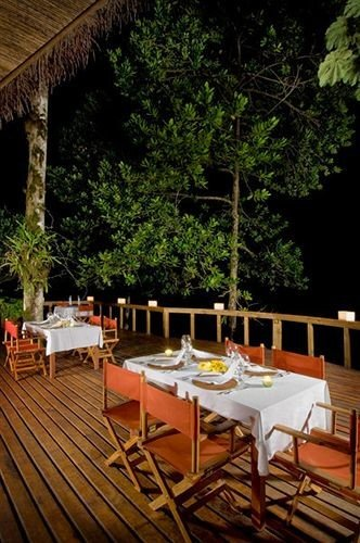 tree chair restaurant Resort Villa outdoor structure eco hotel dining table