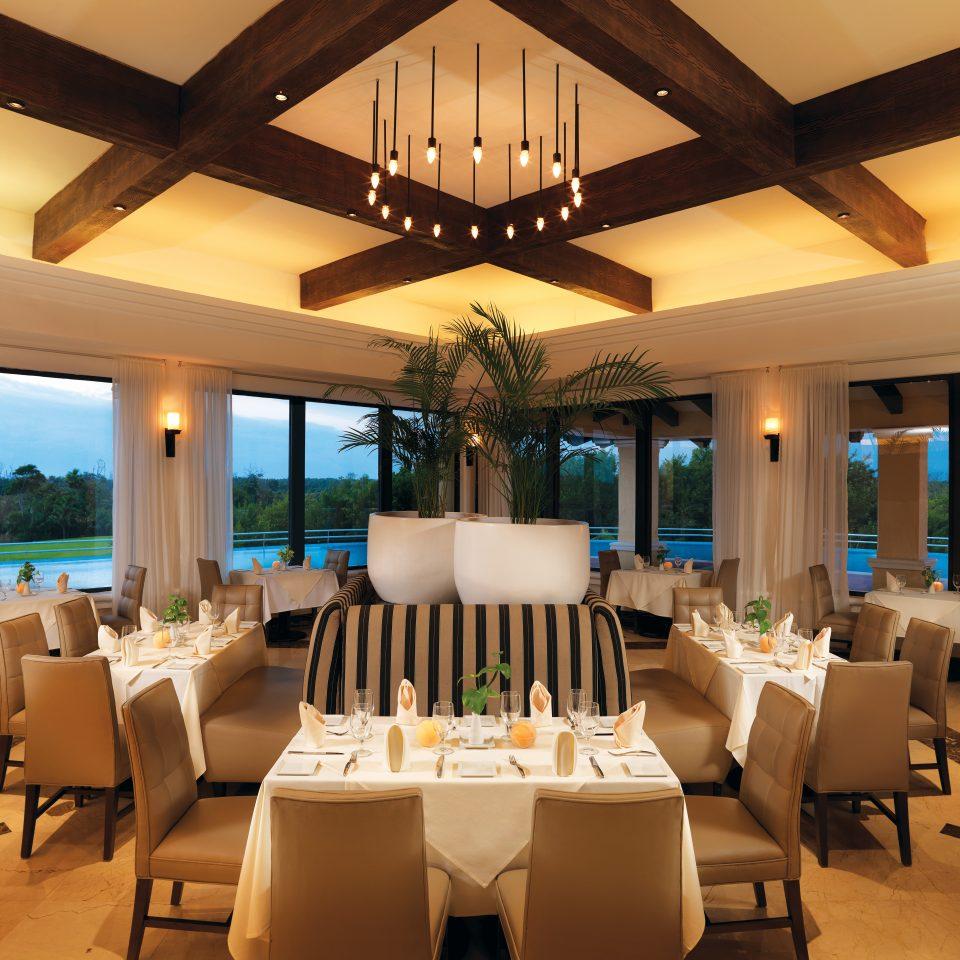 chair property Resort restaurant function hall Villa home living room