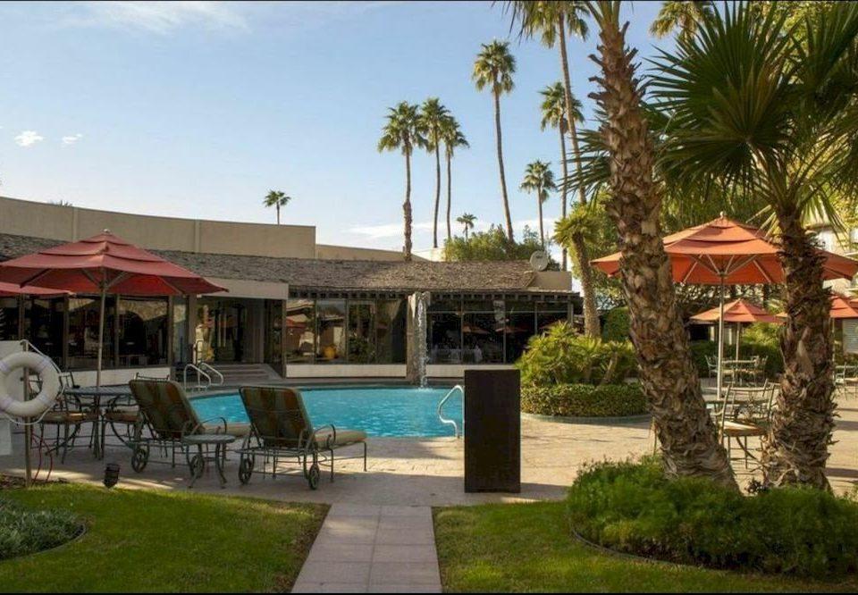 sky grass tree property Resort condominium house home Villa hacienda swimming pool eco hotel mansion palm