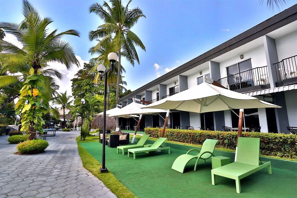 sky tree grass green leisure property condominium Resort Villa swimming pool home lawn palm mansion