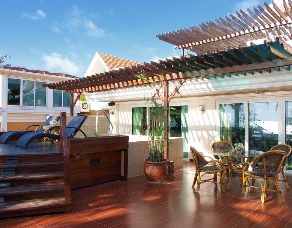 sky property Resort house Villa outdoor structure home wooden condominium