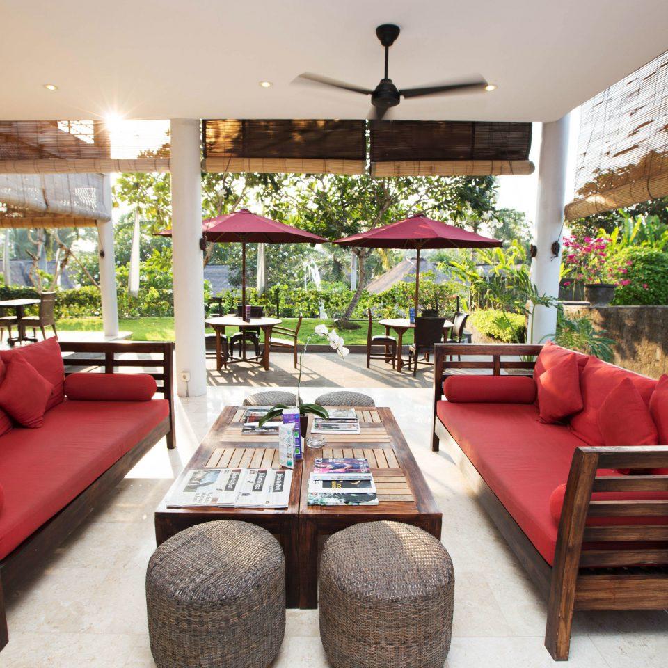 sofa property red living room Resort home Villa porch cottage