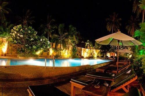 Resort swimming pool landscape lighting eco hotel Villa mansion restaurant night dining table