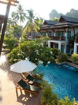 tree property Resort Villa swimming pool home cottage condominium mansion hacienda eco hotel caribbean backyard Village house