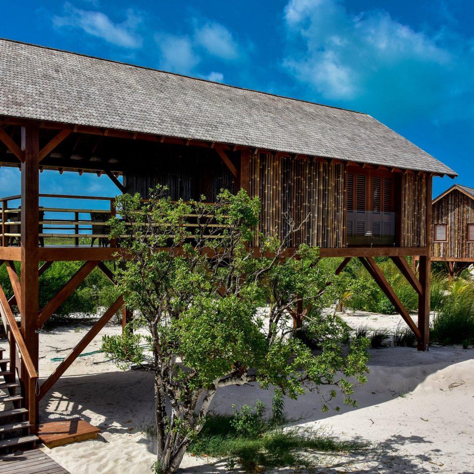 sky ground building house property Resort home cottage wooden Village hut Villa