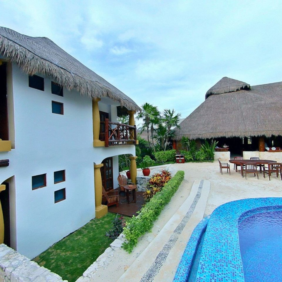 sky property house Resort swimming pool Villa home Village cottage hacienda mansion roof stone