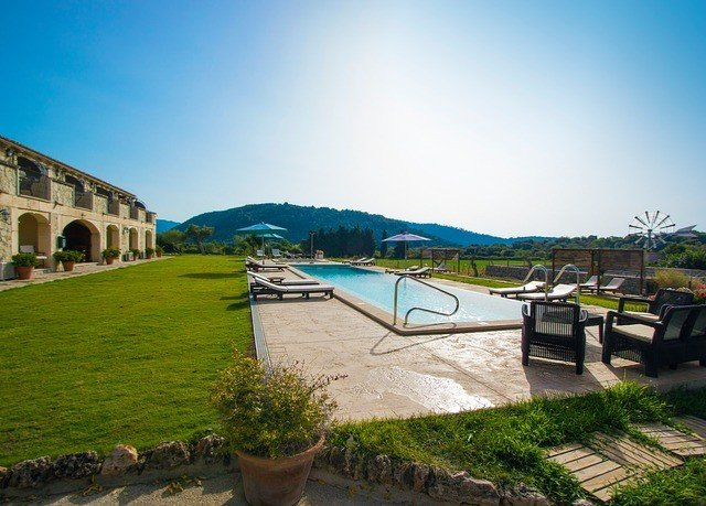 sky grass property structure sport venue Resort Village Villa stone
