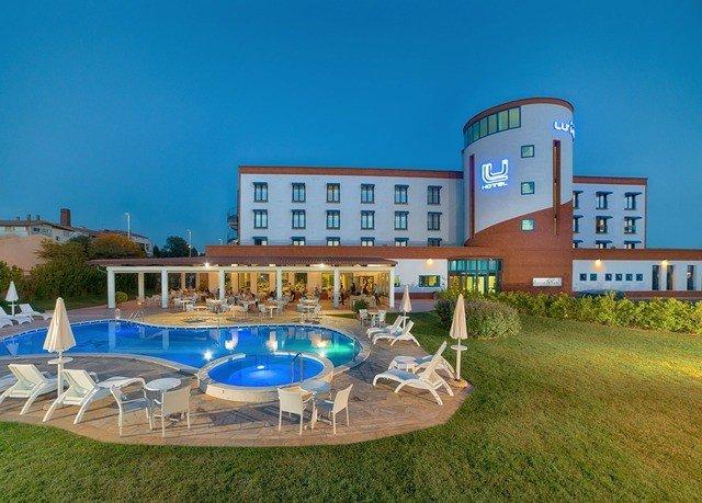 grass sky leisure swimming pool property building Resort condominium leisure centre Villa plaza Water park mansion