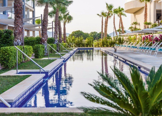 tree swimming pool leisure Resort condominium reflecting pool walkway Water park marina park dock amusement park