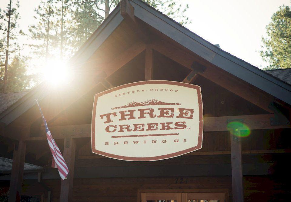 tree sign signage shape restaurant