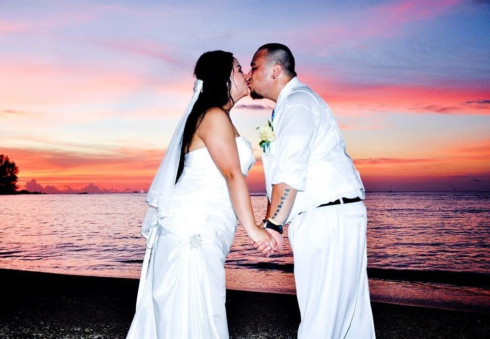 water photograph man woman bride ceremony wedding groom Romance event interaction marriage Sunset posing