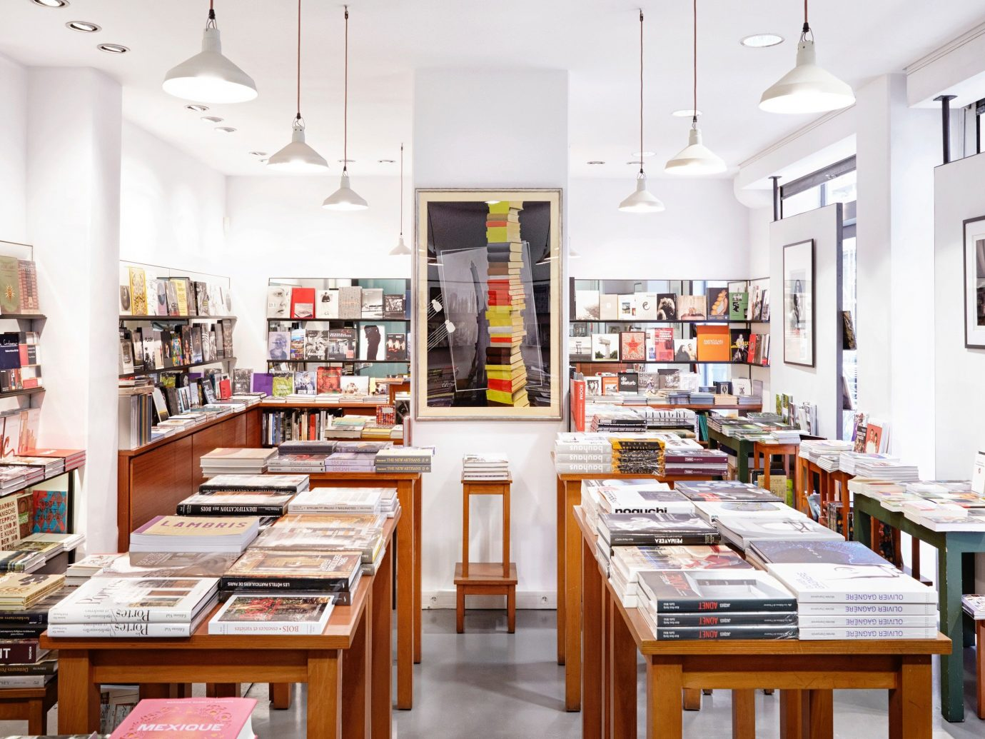 France Paris Trip Ideas indoor table floor book shelf bookselling room building retail library interior design Design real estate wood furniture cluttered