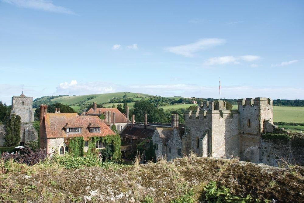 grass sky building castle Village fortification historic site medieval architecture château Ruins tours land lot middle ages abbey stone