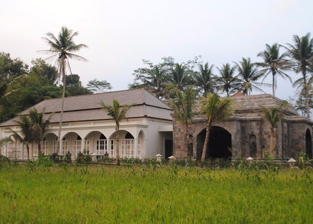 grass sky building property archaeological site Village hacienda place of worship Ruins arch lush
