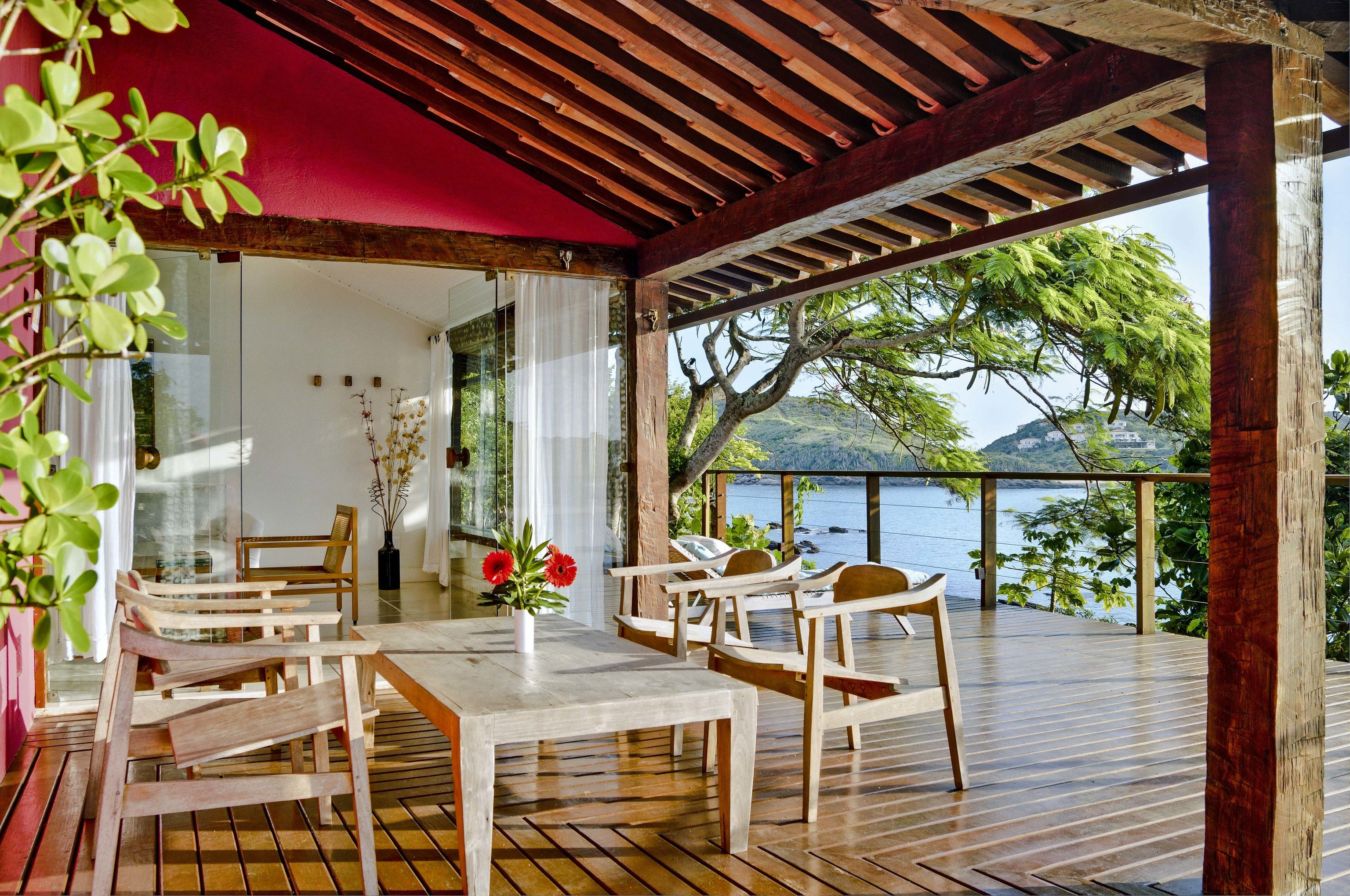Beaches Brazil Trip Ideas chair building property ceiling Dining real estate outdoor structure Balcony estate wooden Resort porch interior design house Patio furniture Villa pergola backyard area