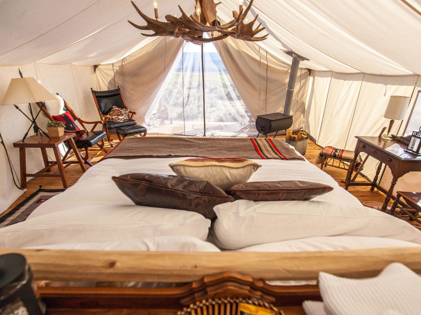 Glamping Outdoors + Adventure Weekend Getaways indoor room estate interior design Suite cottage bed sheet Resort Bedroom