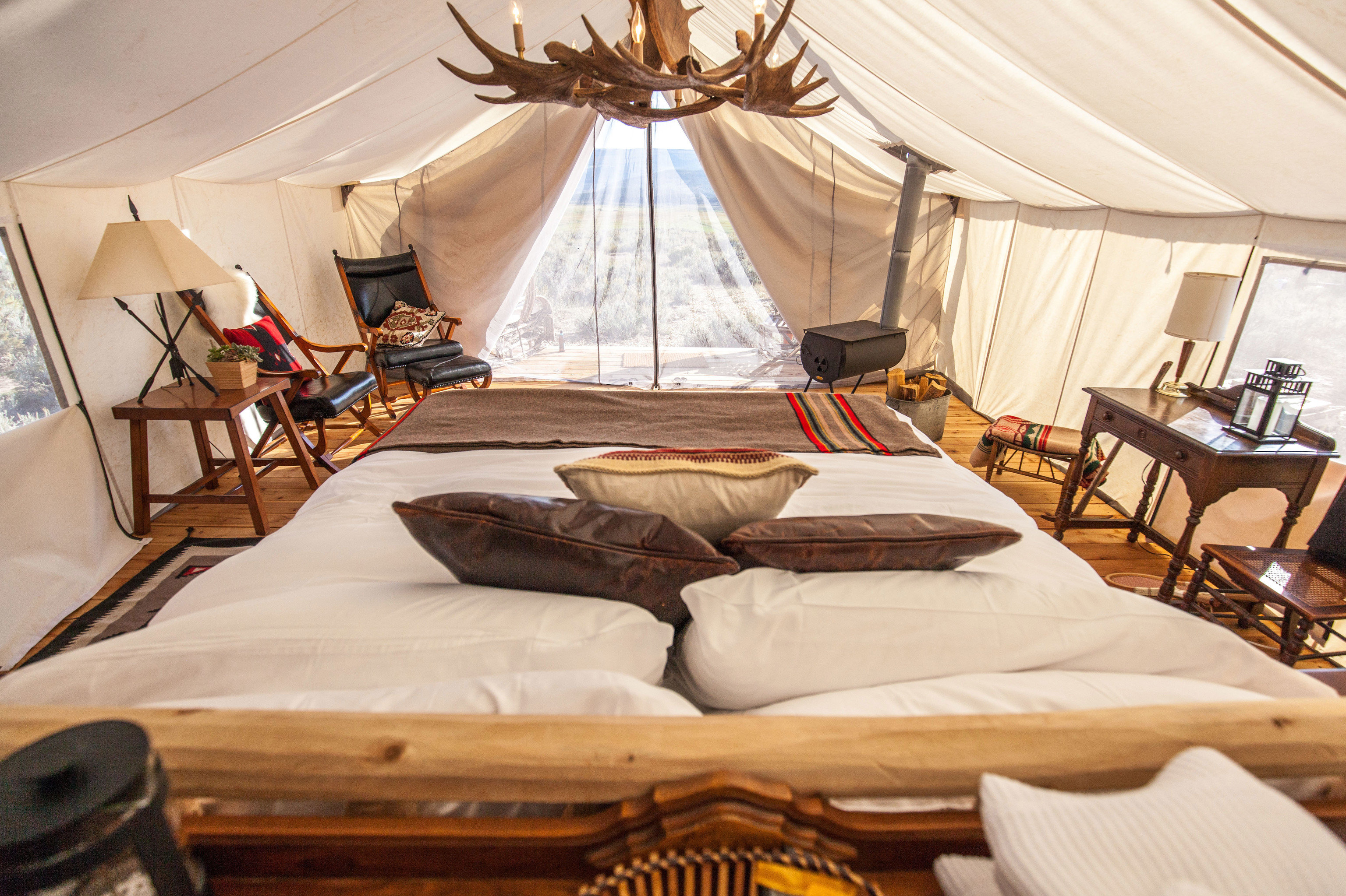 Glamping Outdoors + Adventure Weekend Getaways indoor room estate interior design Suite cottage bed sheet Resort Bedroom