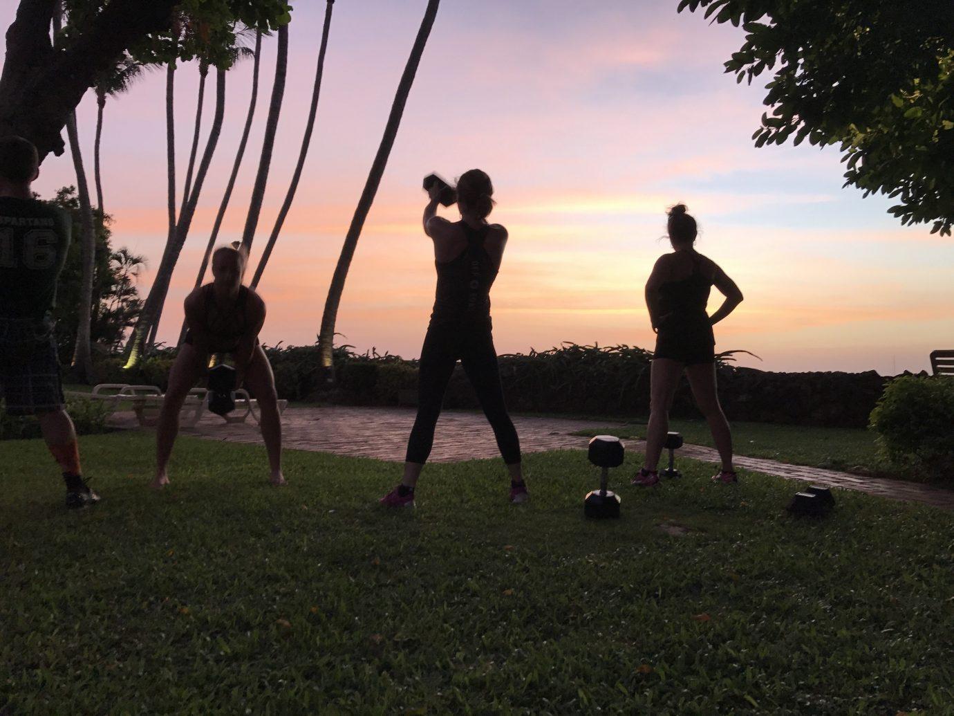 Health + Wellness Meditation Retreats Trip Ideas Yoga Retreats outdoor grass sky tree Sunset sunlight silhouette